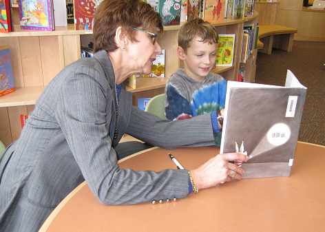 photo of a teacher reading with a student