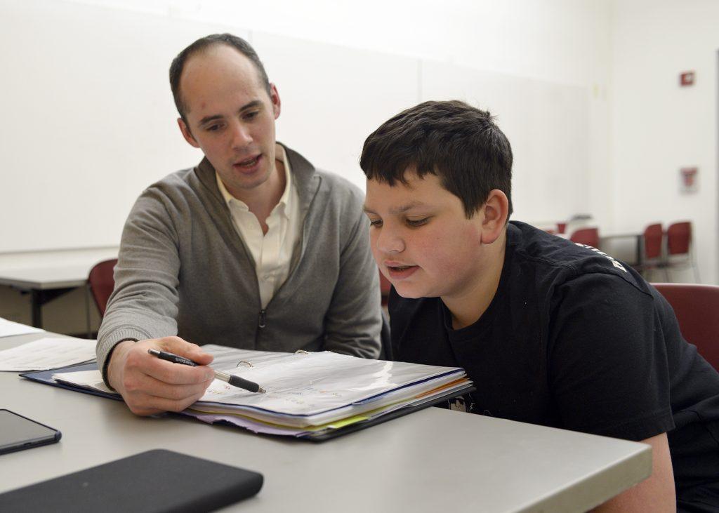 boy sitting with Gateways bar mitzvah tutor