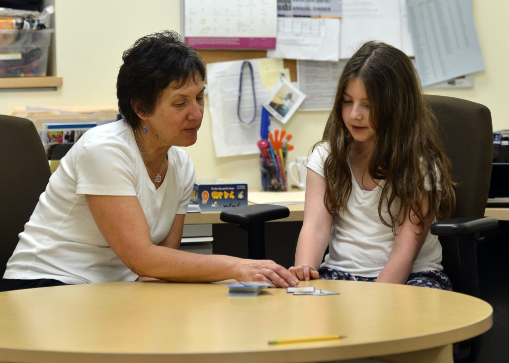 photo of a day school therapist working with a student