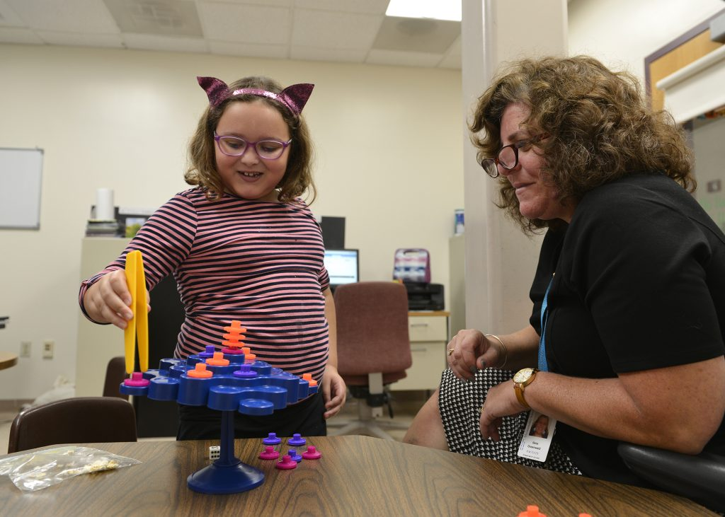 photo of occupational therapist working with student