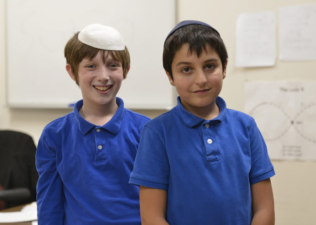 photo of two day school students standing next to each other smiling
