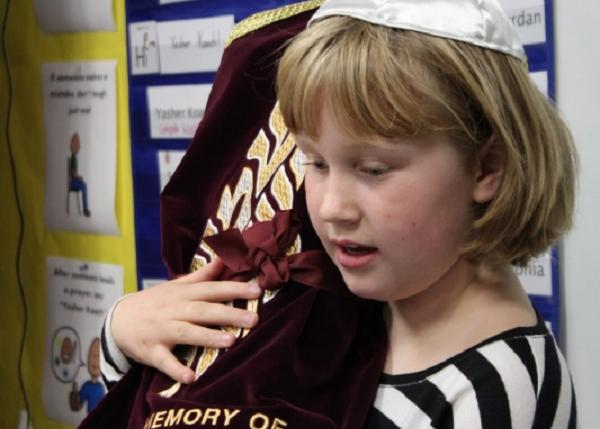 Girl holding Torah