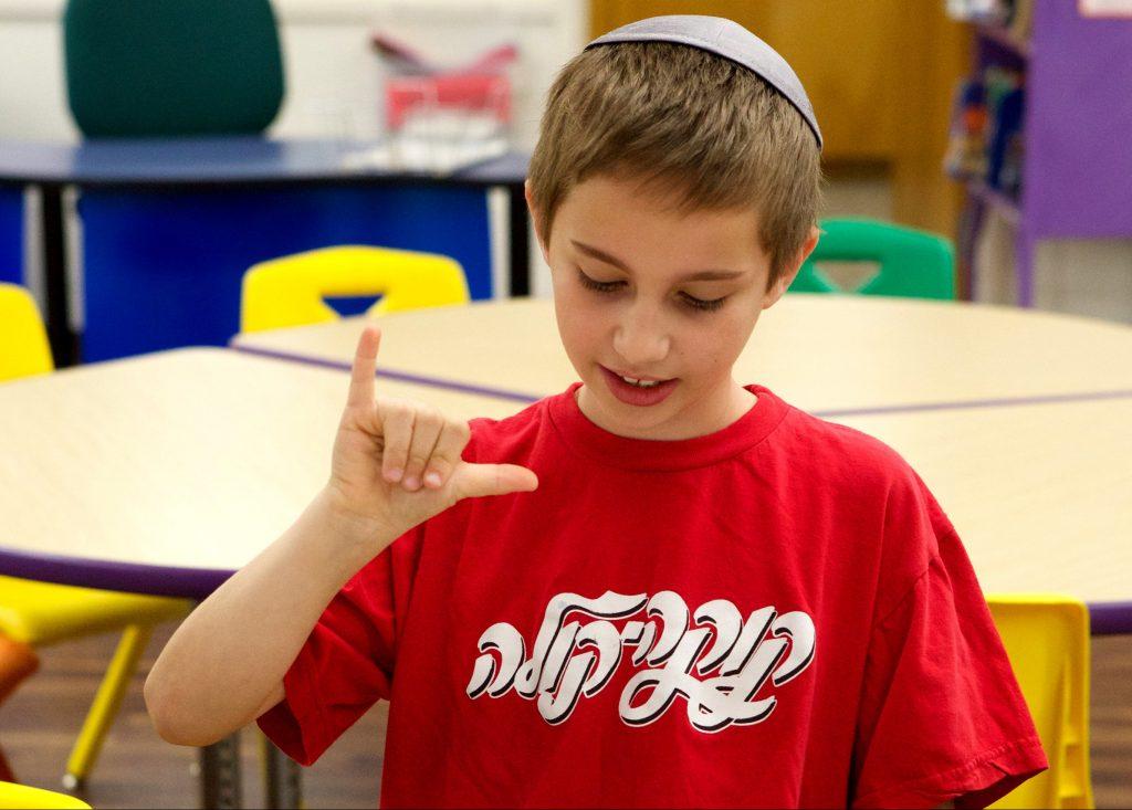 boy practicing sign language