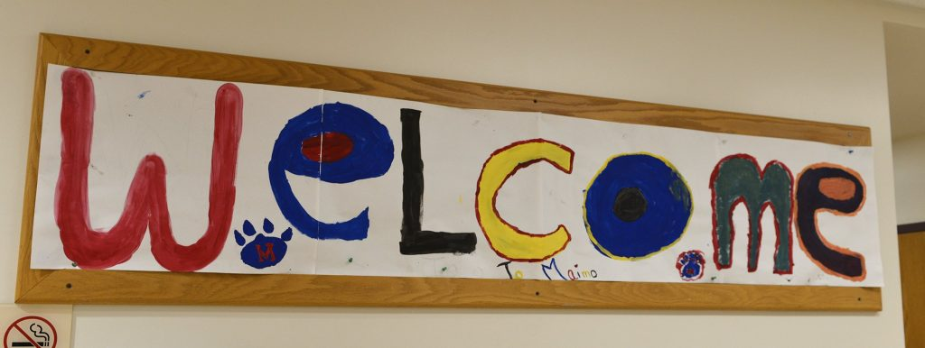 """photo of a painted banner that says """"Welcome"""""""