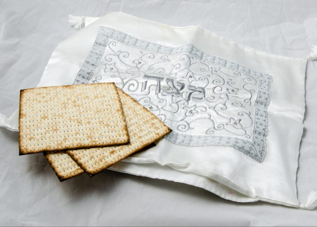 photo of three pieces of matzah and a matzah cover