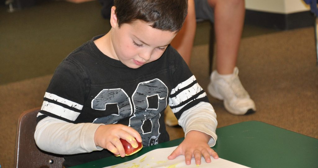 photo of a student doing apple pomander activity