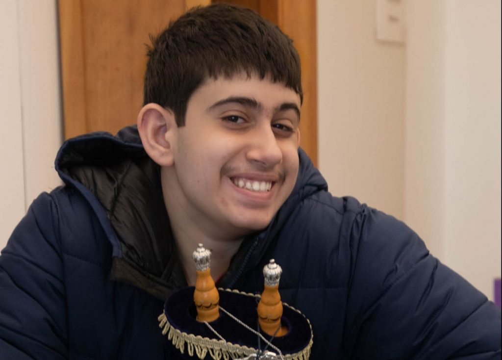 Boy holding Torah and smiling