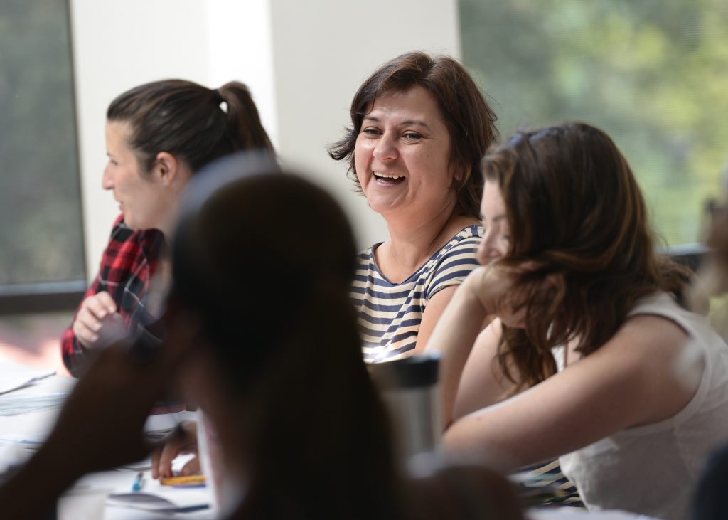 Educators smiling at a workshop