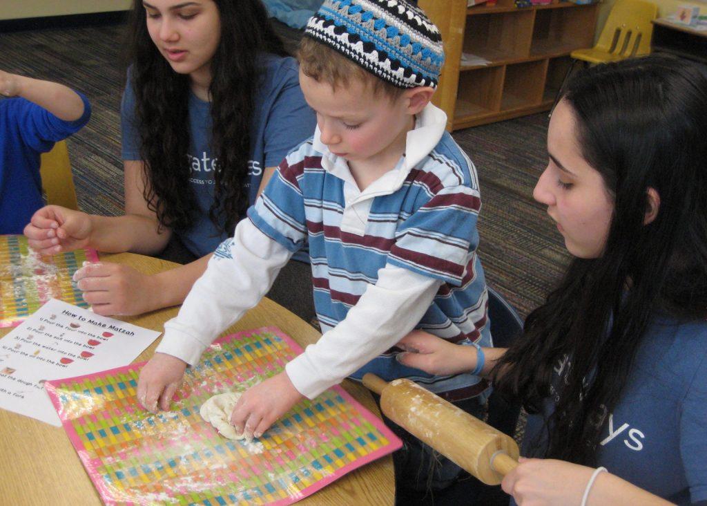 volunteers and student making matzah