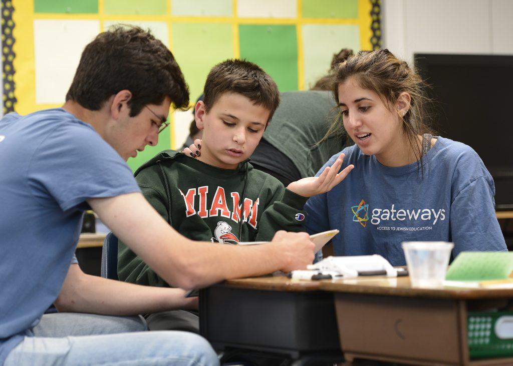 Sam and his teen volunteers