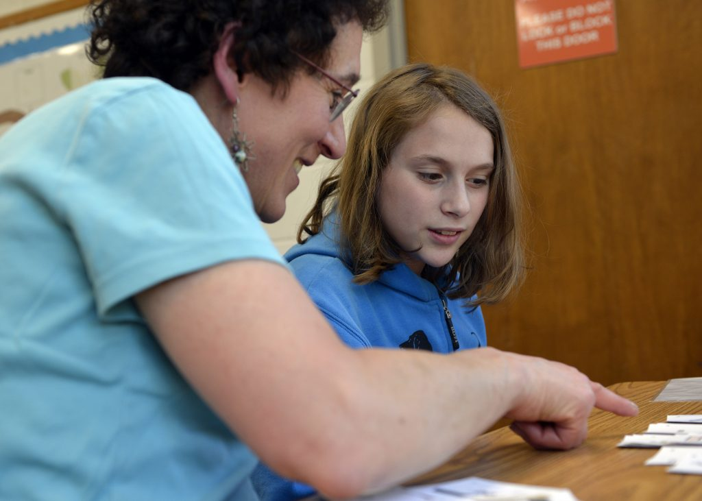 Girl learning with her Bat Mitzvah tutor