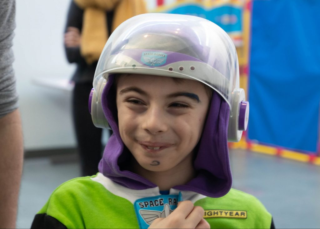 boy smiling in a costume