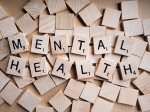 words mental health spelled in scrabble tiles
