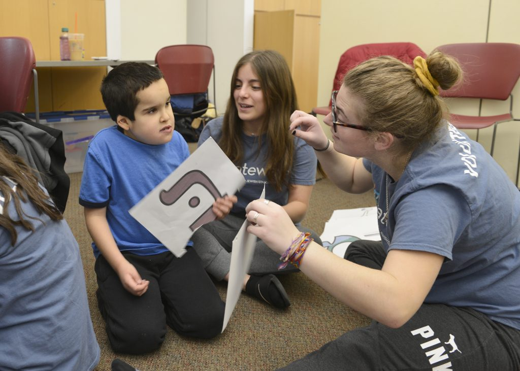 volunteers and student using the Gateways Hebrew Program