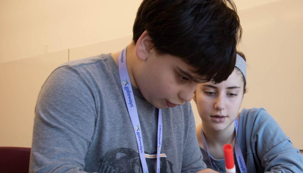 mitzvah mensches student working with a volunteer