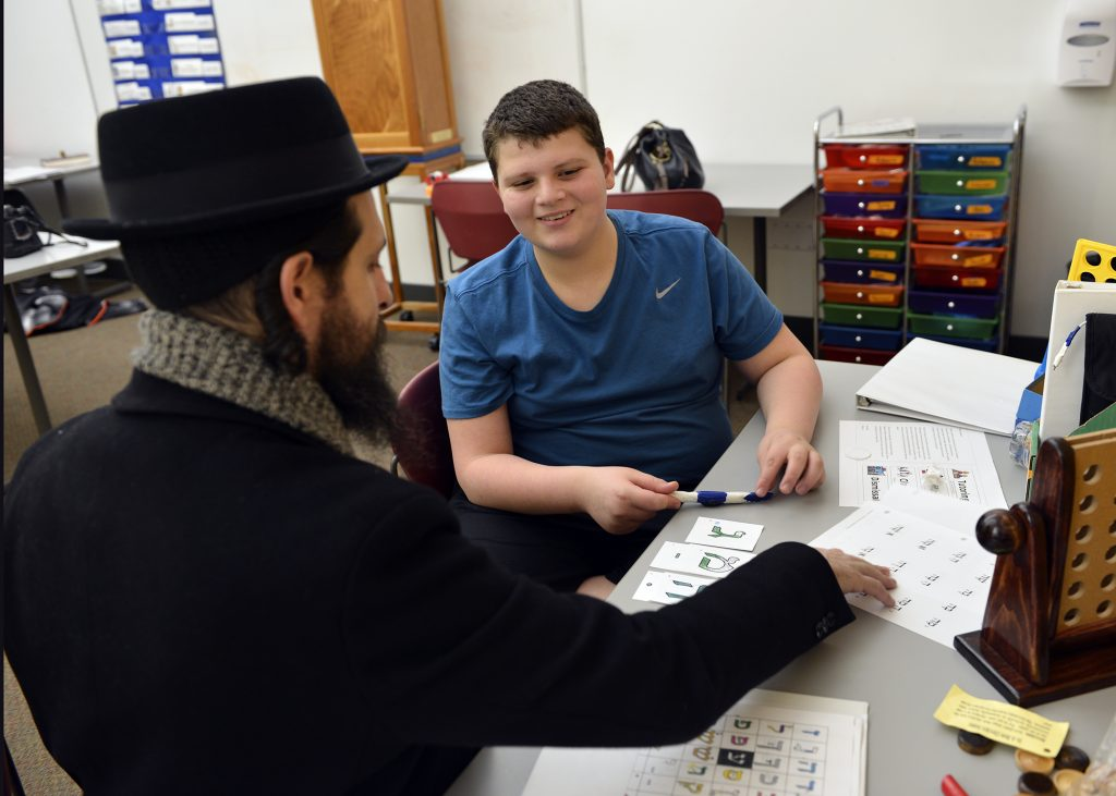 photo of a B'nei Mitzvah student and tutor smiling