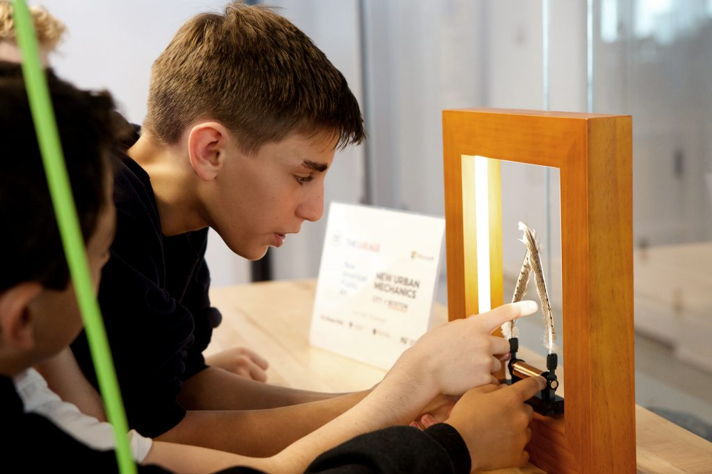 photo of a student completing a disability awareness activity with a mirror